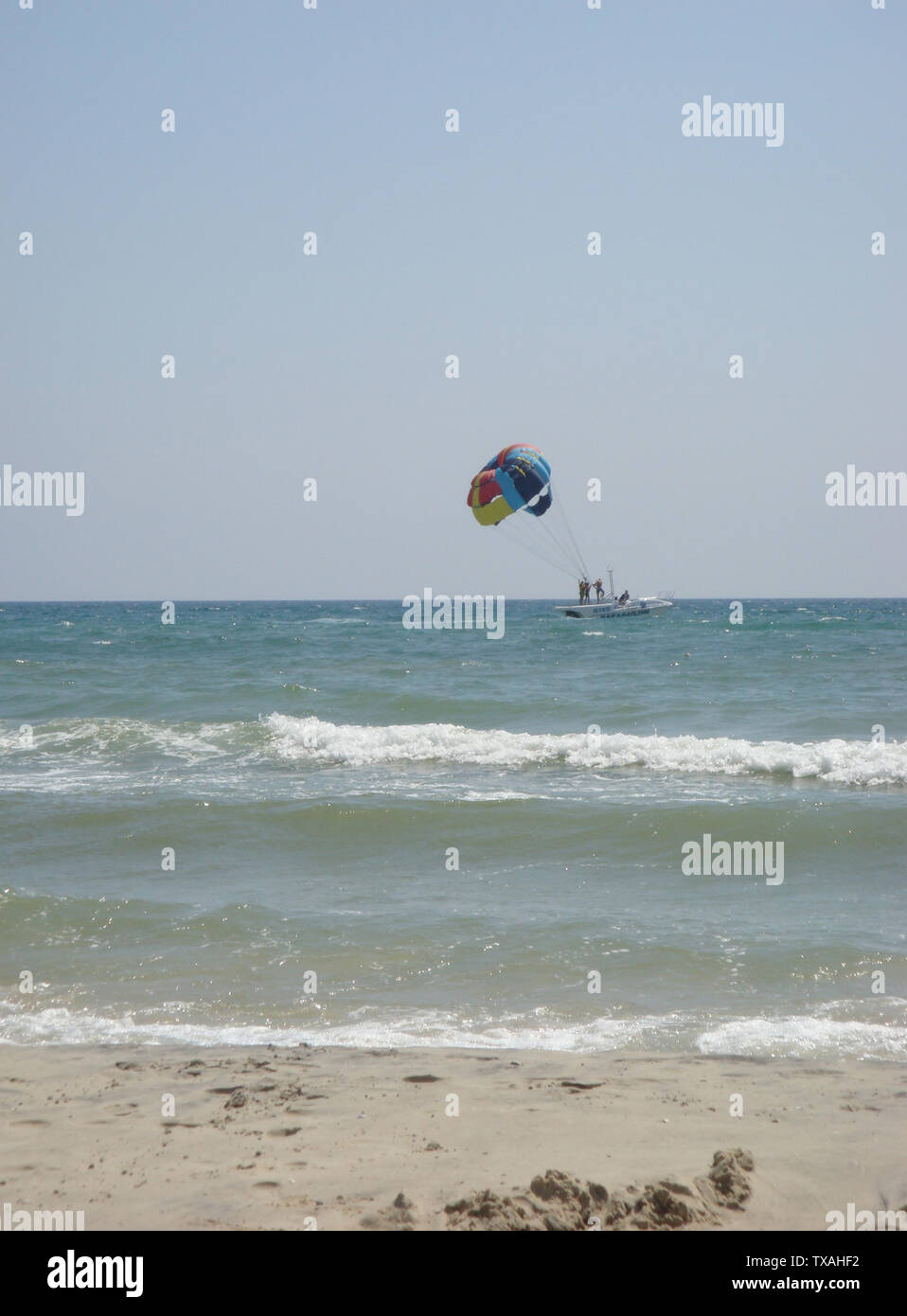 Parasailing over the sea. Flying a tandem paraglider over the sea with views of the horizon. Free time spent actively wonderful experiences vacation, - Stock Image