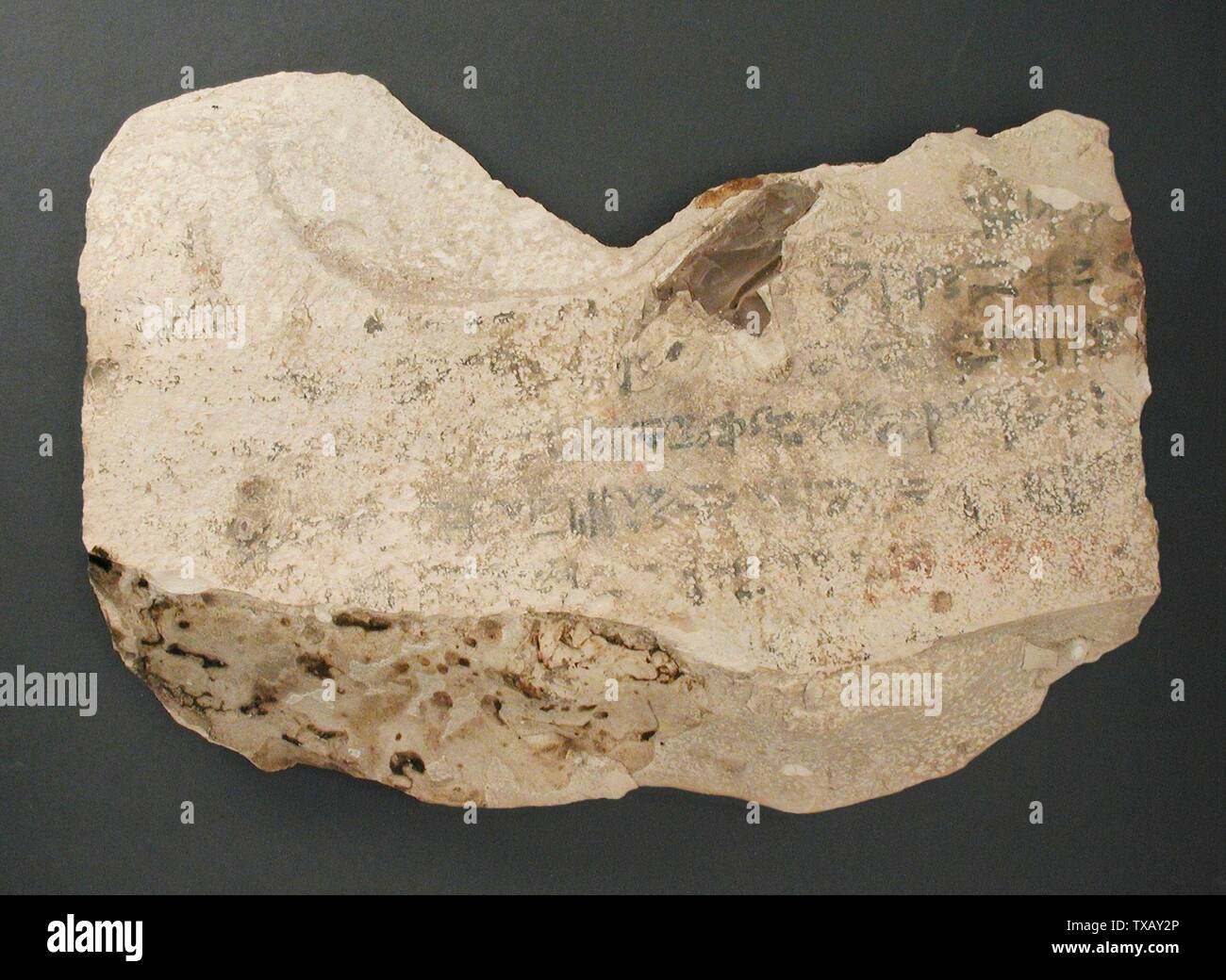 'Ostracon in Three Fragments with Practice Inscriptions of a Hieratic Bird Sign on the Recto and a Hieratic Wisdom Text on the Verso; Egypt, New Kingdom, 18th - 20th Dynasty (1504 - 1081 BCE) Tools and Equipment; ostraka Limestone a) 7 1/2 x 11 1/16 in.  (19 x 28 cm); b) 4 1/4 x 7 5/16 in. (10.8 x 18.5 cm); c) 5 1/2 x 6 11/16 in.  (14 x 17 cm) Gift of Carl W. Thomas (M.80.203.209a-c) Egyptian Art; 18th - 20th Dynasty (1504 - 1081 BCE); ' - Stock Image
