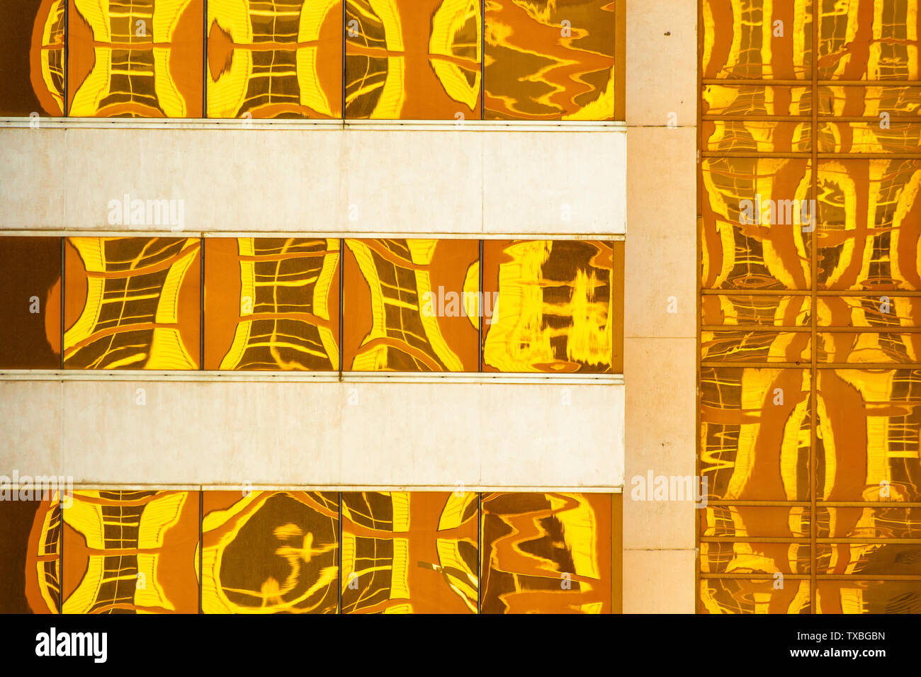 Abstract created by Golden yellow reflections on modern building windows Stock Photo
