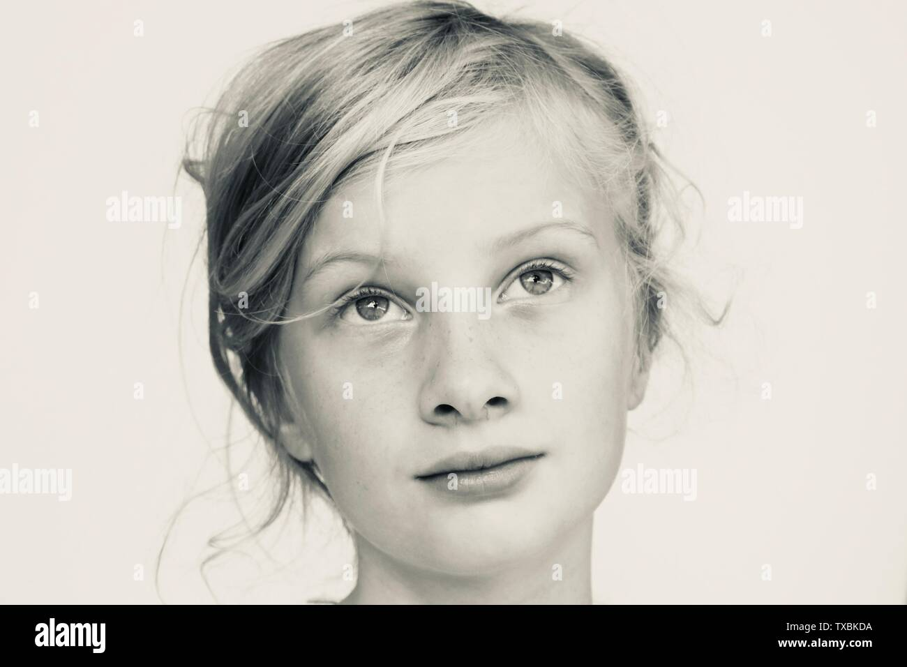 Portrait of a young girl looking wistful in black and white Stock Photo