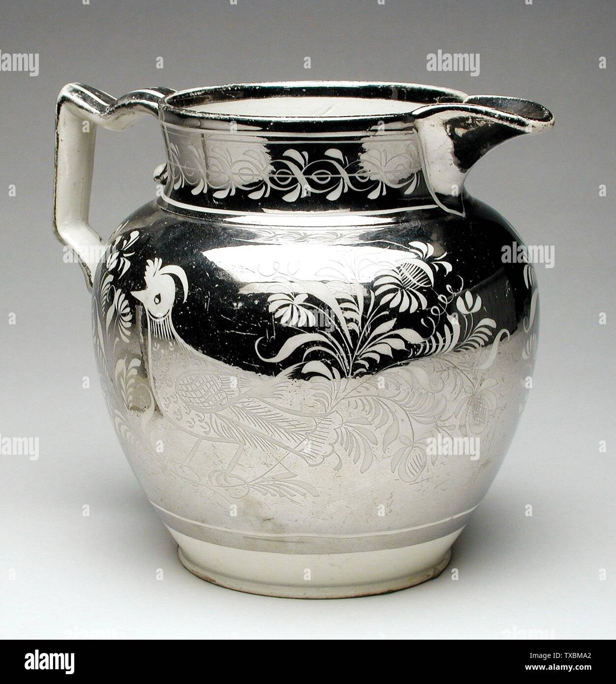 """Pitcher; English:  England, circa 1810 Furnishings; Serviceware Pearlware (earthenware), silver lustre Height:  5 1/4 in. (13.34 cm); Diameter of base:  3 in. (7.62 cm) Gift of Mrs. Anna Bing Arnold (M.73.28.7) Decorative Arts and Design; circa 1810 date QS:P571,+1810-00-00T00:00:00Z/9,P1480,Q5727902; "" Stock Photo"