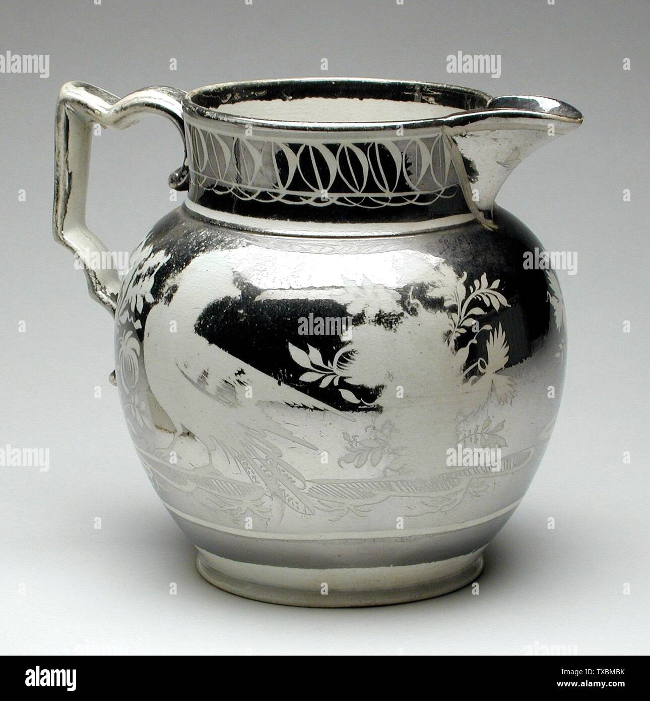 'Pitcher; English:  England, 1820 Furnishings; Serviceware Porcelain (creamware), lustre Height:  5 1/2 in. (13.97 cm); Diameter:  6 1/2 in. (16.51 cm) Gift of Mrs. Anna Bing Arnold (M.73.28.6) Decorative Arts and Design; 1820date QS:P571,+1820-00-00T00:00:00Z/9; ' - Stock Image