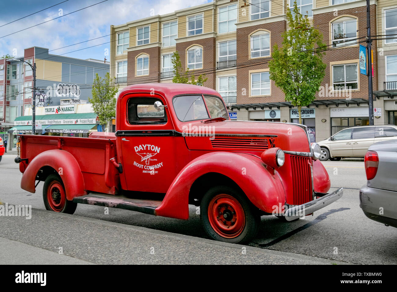 Vintage Dayton Boot Company, red pick up truck, Hastings Street, Vancouver, British Columbia, Canada - Stock Image