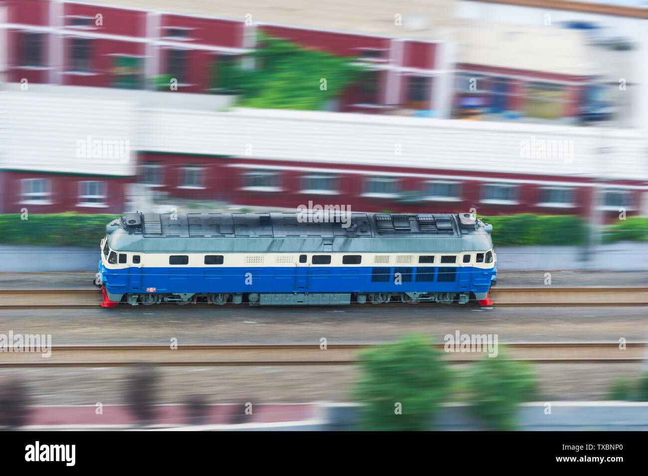 A high-speed internal combustion engine train on a railway. Stock Photo