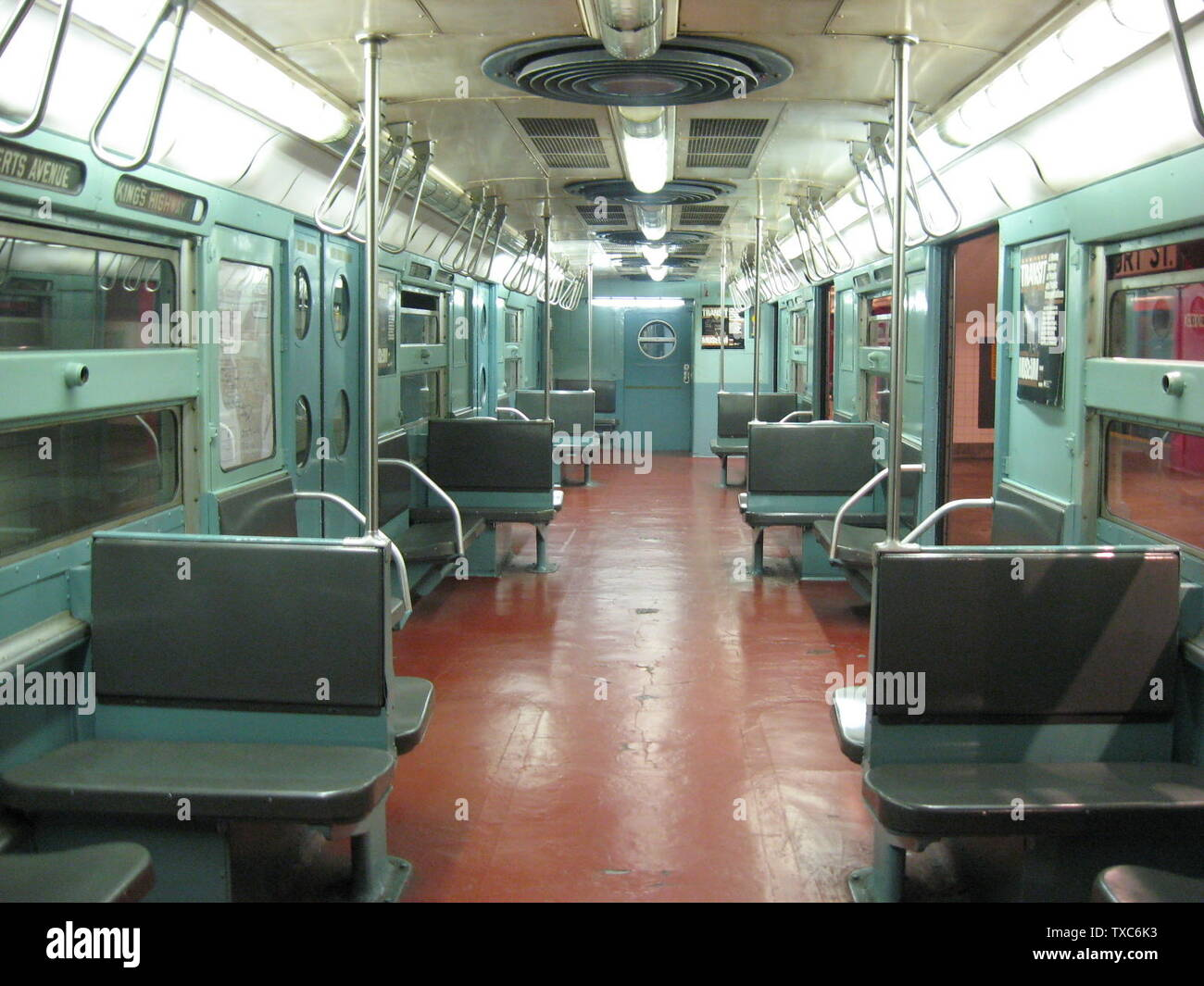 'English: The interior of an R34 subway car as seen from the center aisle. This cars were ordered as part of a test train for a potential order of 400 cars that never materialized and is one of the first cars (along with the other nine from the test train) to be built for the city with a stainless steel body and finish. The cars came with many innovative features of the day, but in time, they were orphaned by the transit system and abandoned to menial shuttle duty along the Franklin Avenue Shuttle. Car 8019 is the only car that remains and is on permanent display at the New York City Transit M - Stock Image