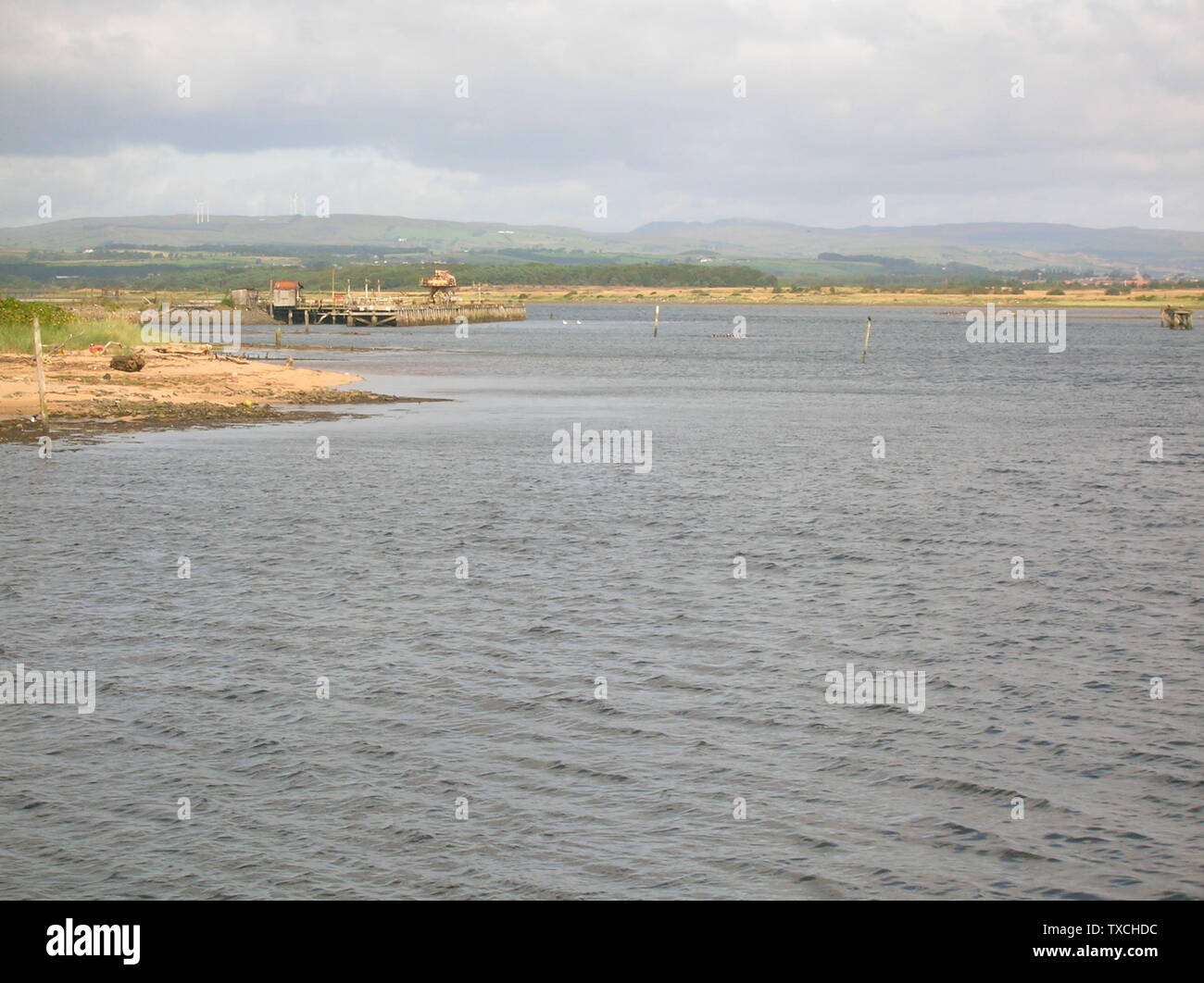 """""""English: The river Garnock at Irvine harbour with the old ICI explosive's jetty to the left. Rosser 20:27, 26 August 2007 (UTC); 26 August 2007 (original upload date); Own work; Rosser1954 at English Wikipedia; """" Stock Photo"""