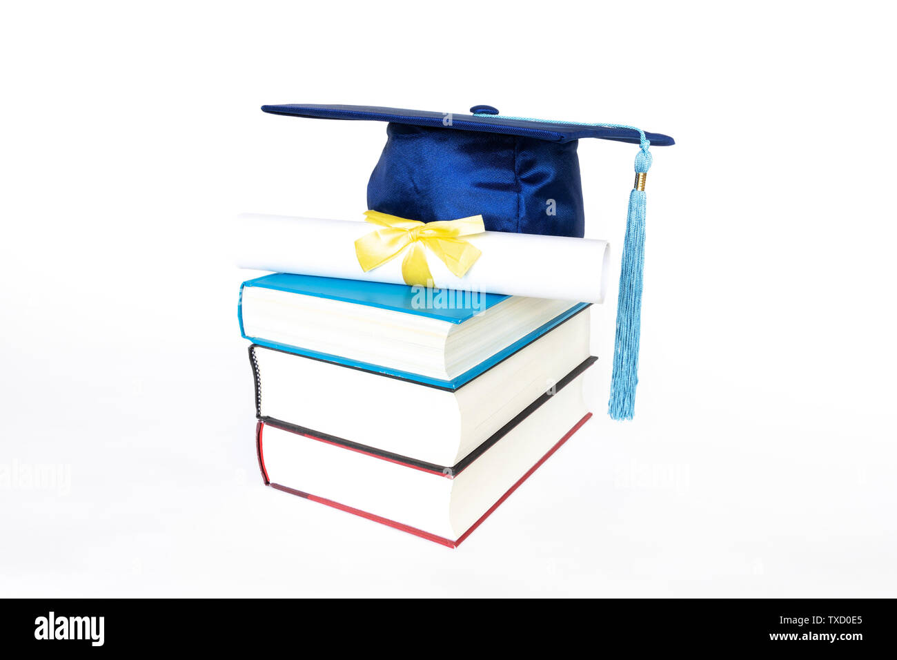 Blue graduation cap with diploma on top of books isolated on white background. Education concept. - Stock Image