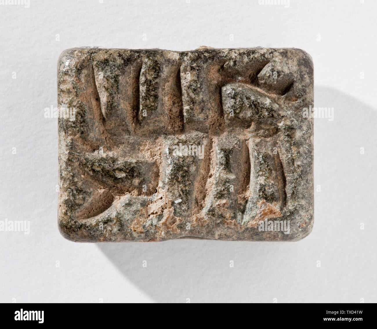 """Stamp Seal, Tabloid (image 2 of 2); Tools and Equipment; seals Gray serpentine Height:  1/2 in. (1.2 cm); Width:  15/16 in. (2.24 cm); Length:  1 3/16 in. (3 cm) Gift of Nasli M. Heeramaneck (M.76.174.512) Art of the Ancient Near East; between circa 3500 and circa 3100 date QS:P571,+3500-00-00T00:00:00Z/6,P1319,+3500-00-00T00:00:00Z/9,P1326,+3100-00-00T00:00:00Z/9,P1480,Q5727902 B.C.; "" Stock Photo"