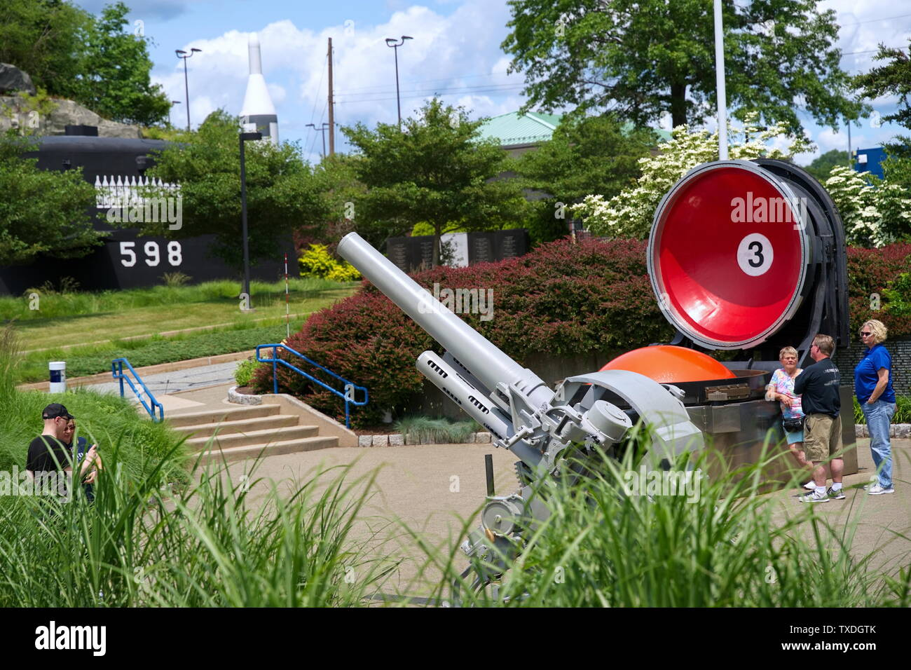 Submarine Force Museum, Groton CT USA, Jun 2019. Tourists taking pictures by deck guns of the past and ballistic missiles in their tubes of today. - Stock Image