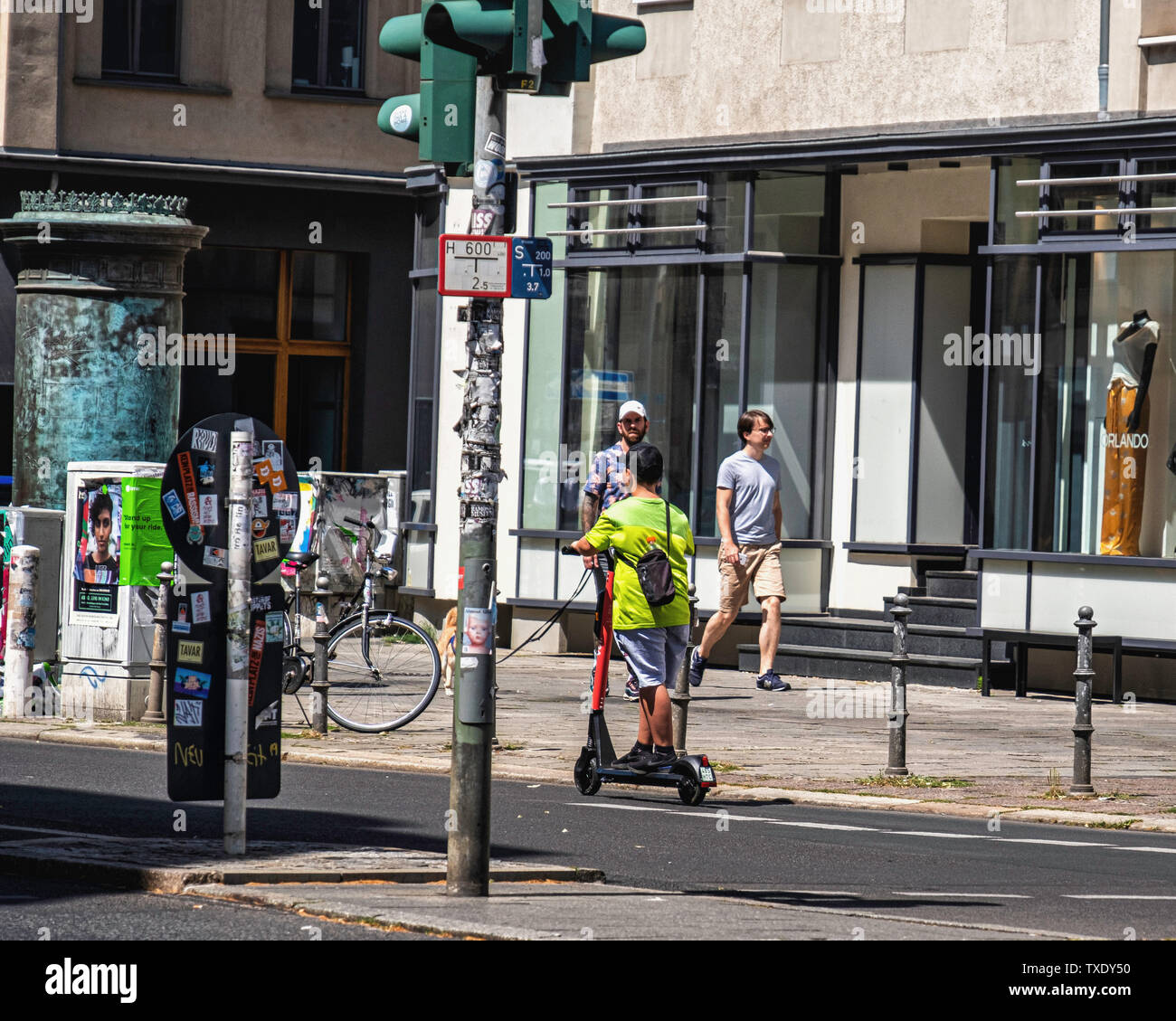 Germany, Berlin, Mitte. 24th June 2019. German parliament legalises electric scooters. E-scooters have recently been made legal for street use in Germany and are making an appearance on city streets. Use is restricted to bike lanes & streets. The maximun speed allowed is 20kpm and under- fourteens are not permitted to use the scooters. Stock Photo