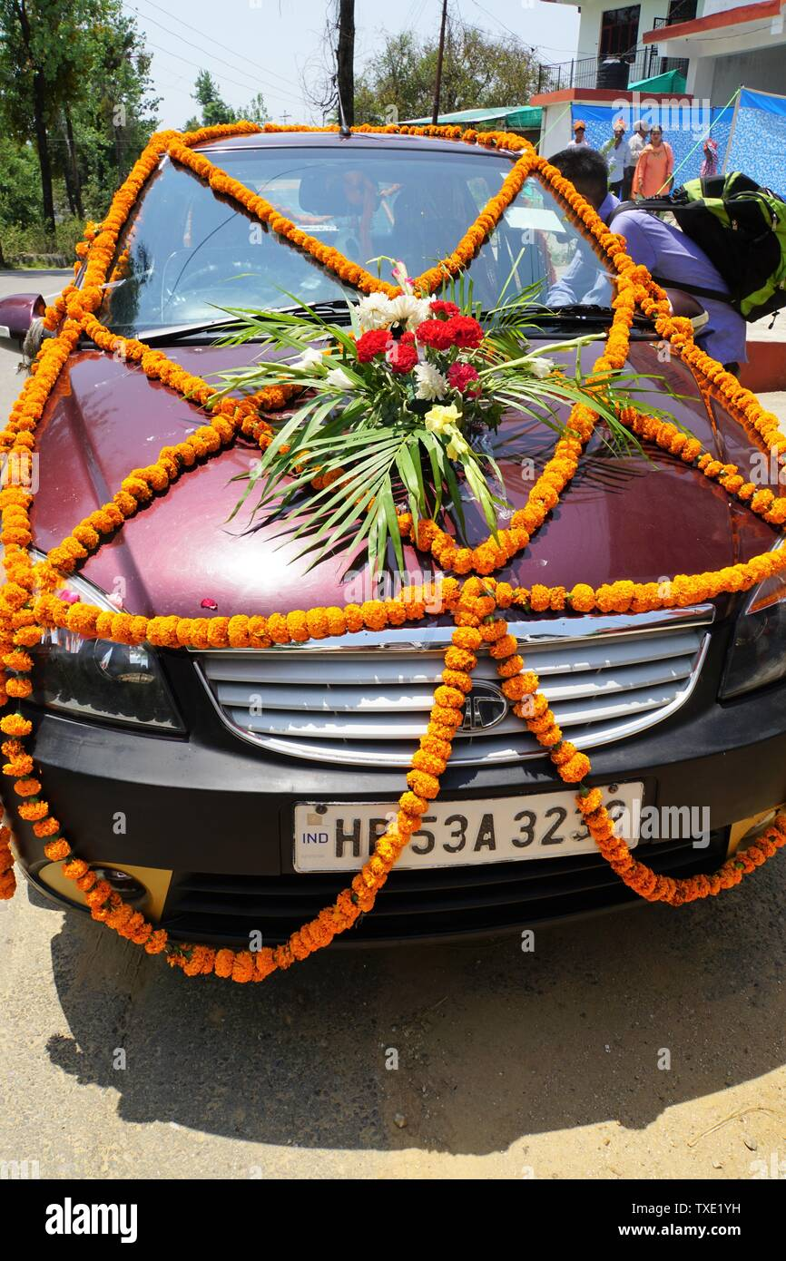 Front View of a Car decorated with Flowers and Garlands on the Occasion of a Wedding Stock Photo