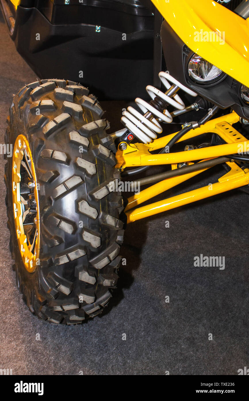 Yellow buggy car suspension close up. Buggy vehicle - Stock Image