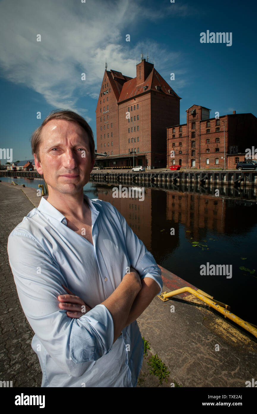Author and Historian Florian Huber on the banks of the Peene River in Demmin. He has written the best selling book; 'Promise me you'll shoot yourself' - Stock Image