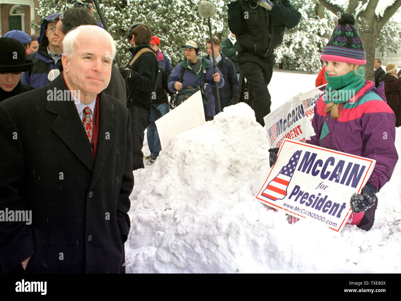HAN2000013104 - 31 JANUARY, 2000 - HANOVER, NEW HAMPSHIRE, USA:  A young supporter waits on top of a snowbank to see Republican presidential candidate U.S. Senator John McCain of Arizona, left, walk by on his way back to the campaign bus after addressing Dartmouth College students in Hanover.  McCain made several quick stops across the state to thank supporters for their help on the final day of campaigning before New Hampshire's first in the nation primary.  lkm/Lee K. Marriner  UPI Stock Photo