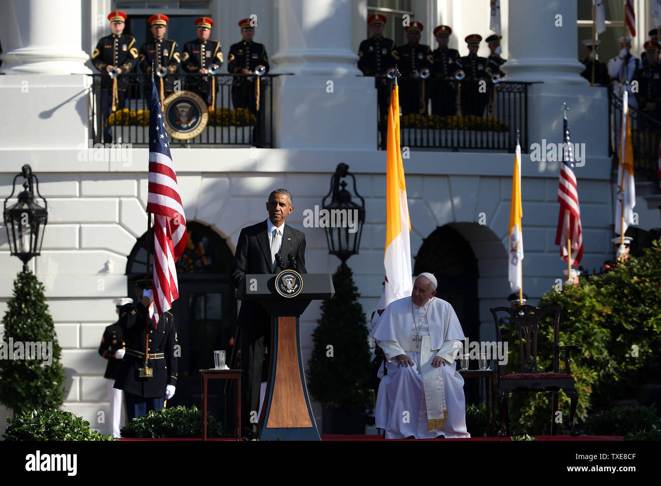 WASHINGTON, DC - SEPTEMBER 23:  U.S. President Barack Obama speaks during the arrival ceremony for Pope Francis at the White House on September 23, 2015 in Washington, DC. The Pope begins his first trip to the United States at the White House followed by a visit to St. Matthew's Cathedral, and will then hold a Mass on the grounds of the Basilica of the National Shrine of the Immaculate Conception.  (Photo by Win McNamee/Getty Images) - Stock Image
