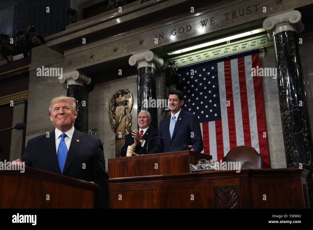 WASHINGTON, DC - JANUARY 30:  U.S. President Donald J. Trump (L) stands at the podium as U.S. Vice President Mike Pence (C) and Speaker of the House U.S. Rep. Paul Ryan (R-WI) (R) look on during the State of the Union address in the chamber of the U.S. House of Representatives January 30, 2018 in Washington, DC. This is the first State of the Union address given by U.S. President Donald Trump and his second joint-session address to Congress.  (Photo by Win McNamee/Getty Images) - Stock Image