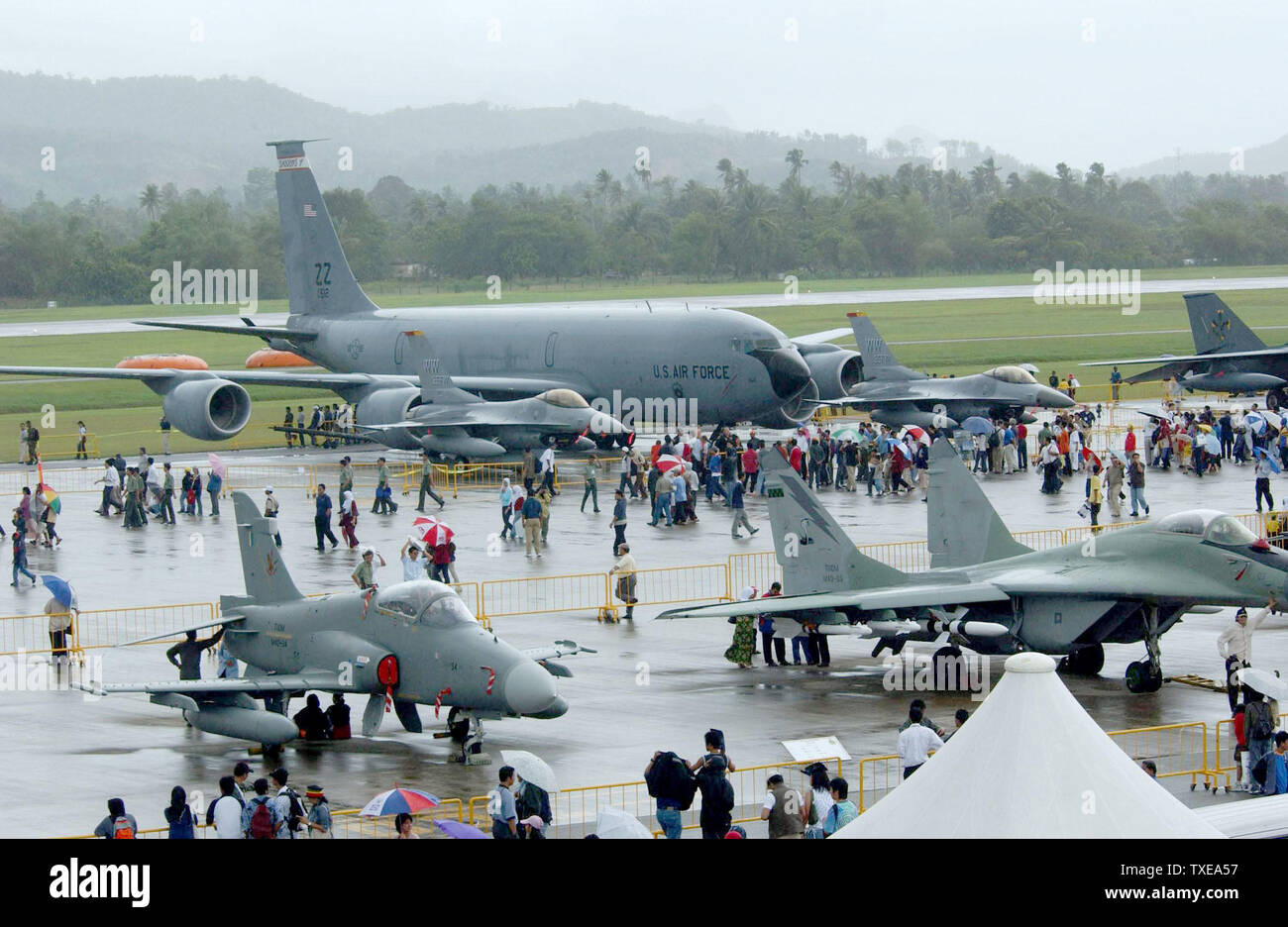 A KC-135 tanker from the 909th Air Refueling Squadron, Kadena Air Base, Japan, and F-16 fighter aircraft from the 35th Fighter Squadron, Misawa Air Base, Japan, is on display on the tarmac during the Langkawi International Maritime and Aerospace exhibition 2003 (LIMA 03) here.  LIMA 03 is one of the premier defense trade show in the world that features over 800 local and international companies and military delegations from about 40 nations that offer state-of-the art aerospace and maritime products. More than 100 aircraft and 80 vessels are on display during the six-day event.     (UPI/AFIE/V - Stock Image