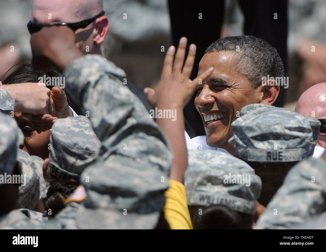 President Barack Obama greets troops at the headquarters for the Army's 3rd Infantry Division in Fort Stewart, Georgia after signing changes to the educational GI Bill on April 27, 2012.   UPI/David Tulis - Stock Image