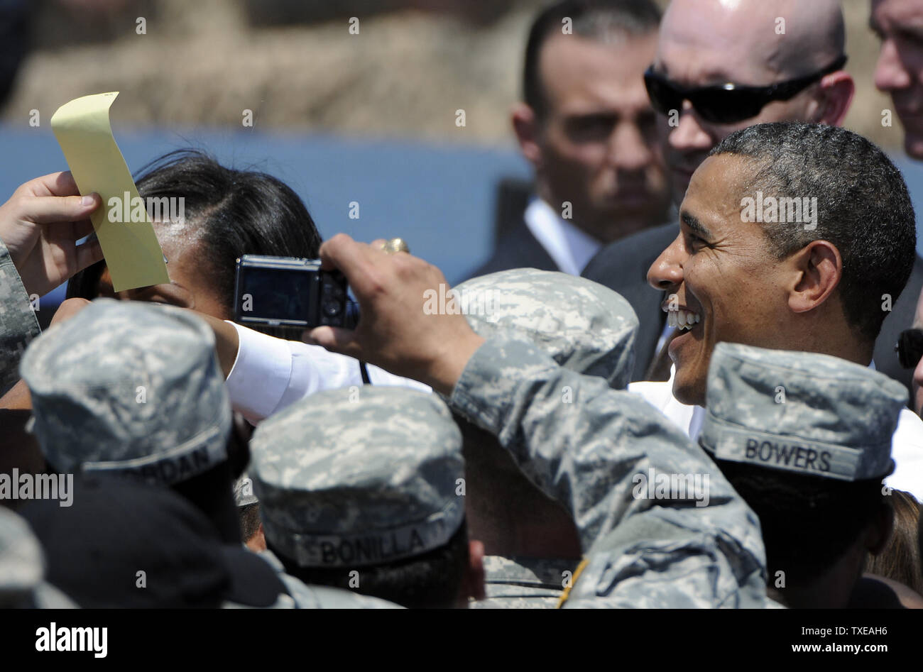 President Barack Obama meets with troops at the headquarters for the Army's 3rd Infantry Division in Fort Stewart, Georgia after a GI Bill signing ceremony on April 27, 2012.   UPI/David Tulis - Stock Image