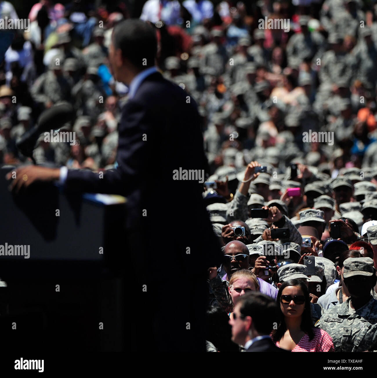 Members of the military take photos of President Barack Obama as he discusses changes to the GI Bill at the headquarters for the Army's 3rd Infantry Division in Fort Stewart, Georgia on April 27, 2012.   UPI/David Tulis - Stock Image