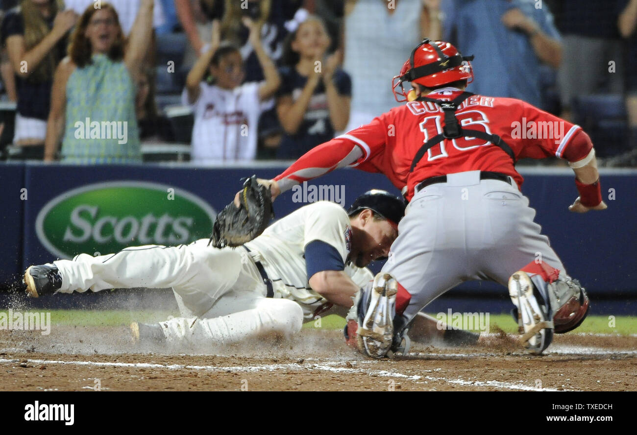 Atlanta Braves' Chris Johnson (L3) is tagged out by Los Angeles Angels catcher Hank Conger (16) as he tries to score on teammate Tommy La Stella's 2RBI double in the sixth inning at Turner Field in Atlanta, June 15, 2014. UPI/David Tulis - Stock Image