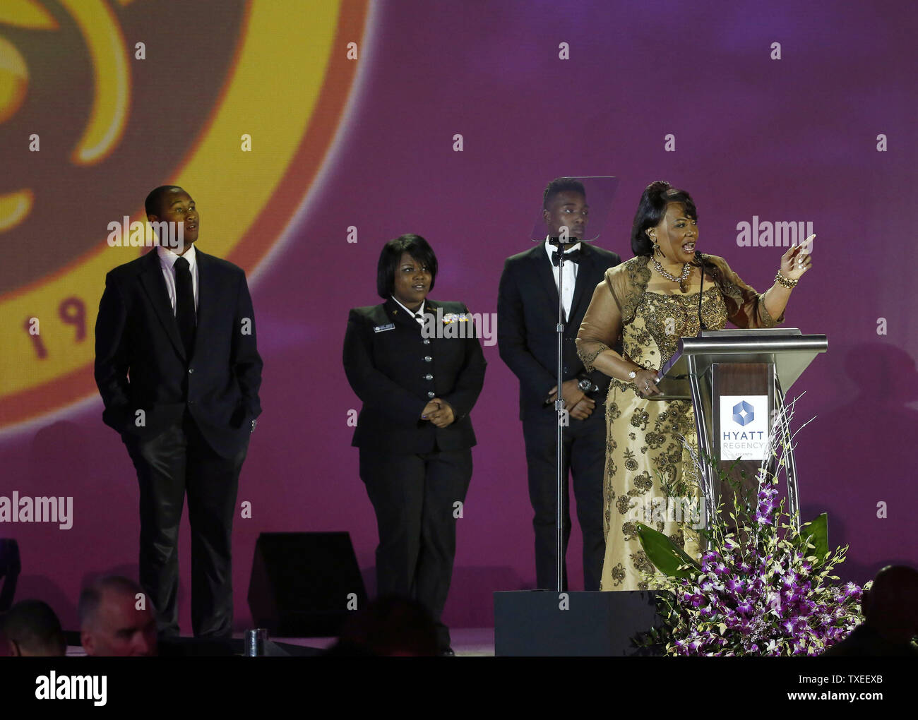The Rev. Bernice King (R) introduces students participating in the Nonviolence 365 program during the 86th birthday celebration for Martin Luther King Jr. during the annual Salute to Greatness Awards Dinner on January 17, 2015, in Atlanta. Photo by David Tulis/UPI - Stock Image