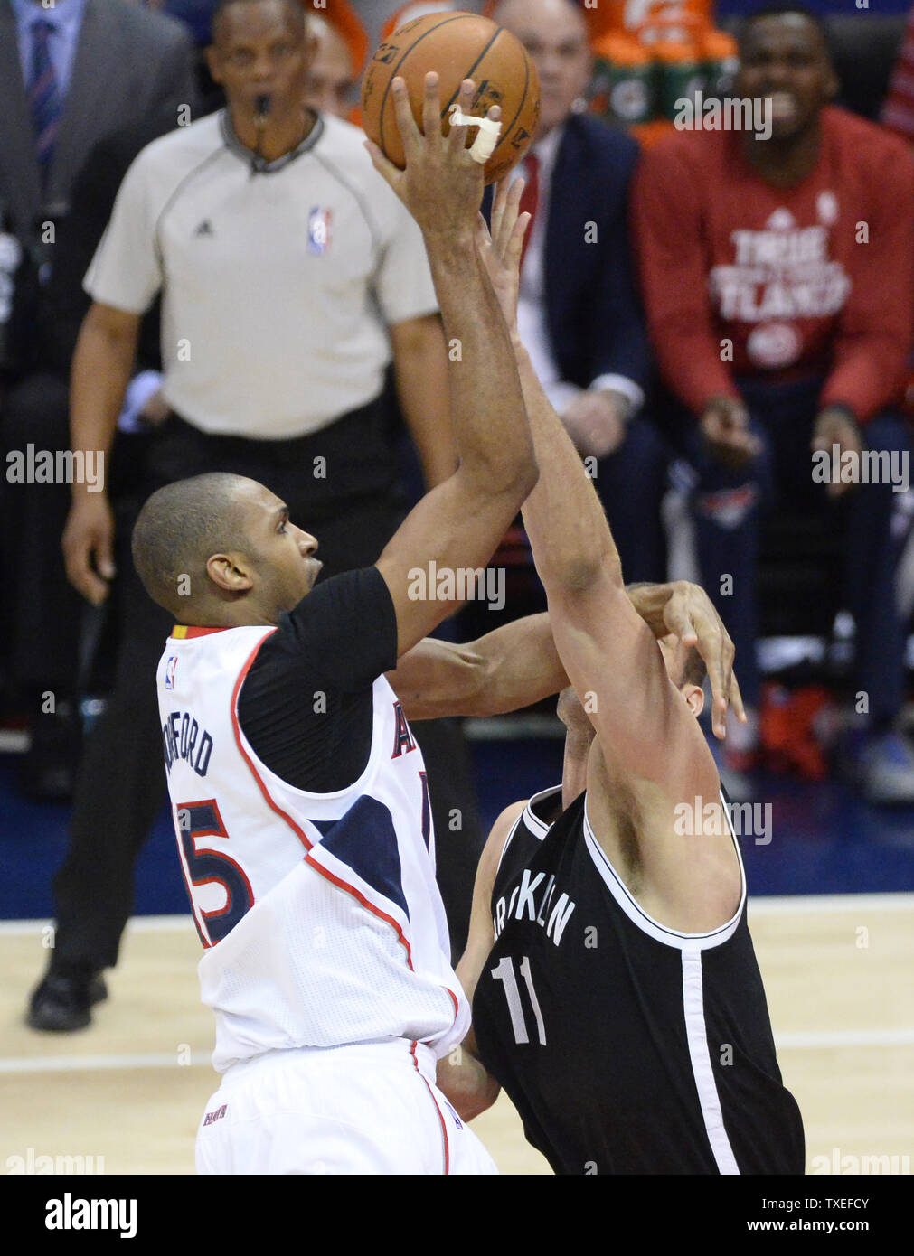 Atlanta Hawks' Al Horford (15) makes contact with Brooklyn Nets' Brook Lopez (11) as he shoots a basket during the first half of Game 2 in the NBA first round playoffs at Philips Arena in Atlanta, April 22, 2015. Photo by David Tulis/UPI Stock Photo
