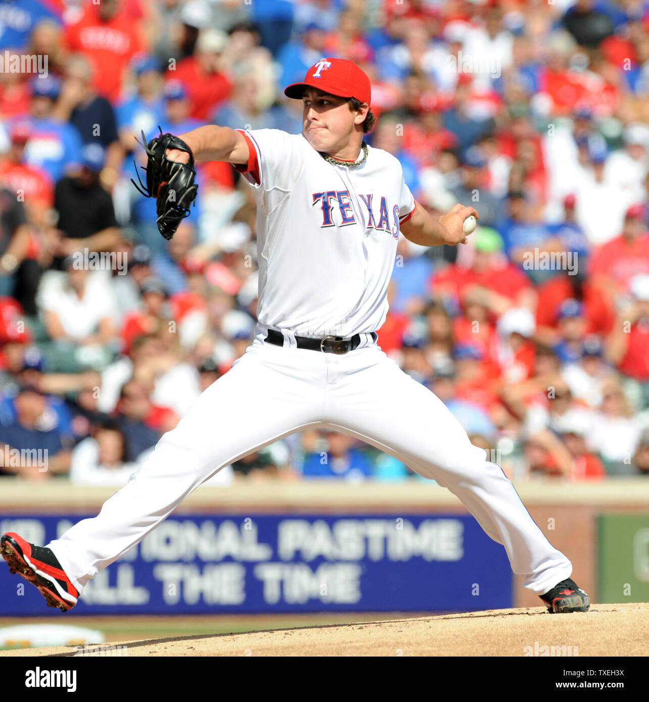 Texas Rangers starting pitcher Derek Holland throws against the Detroit Tigers in game two of the ALCS at Rangers Ballpark in Arlington on October 10, 2011 in Arlington, Texas.   The Rangers lead the best of seven series 1-0.   UPI/Ian Halperin Stock Photo