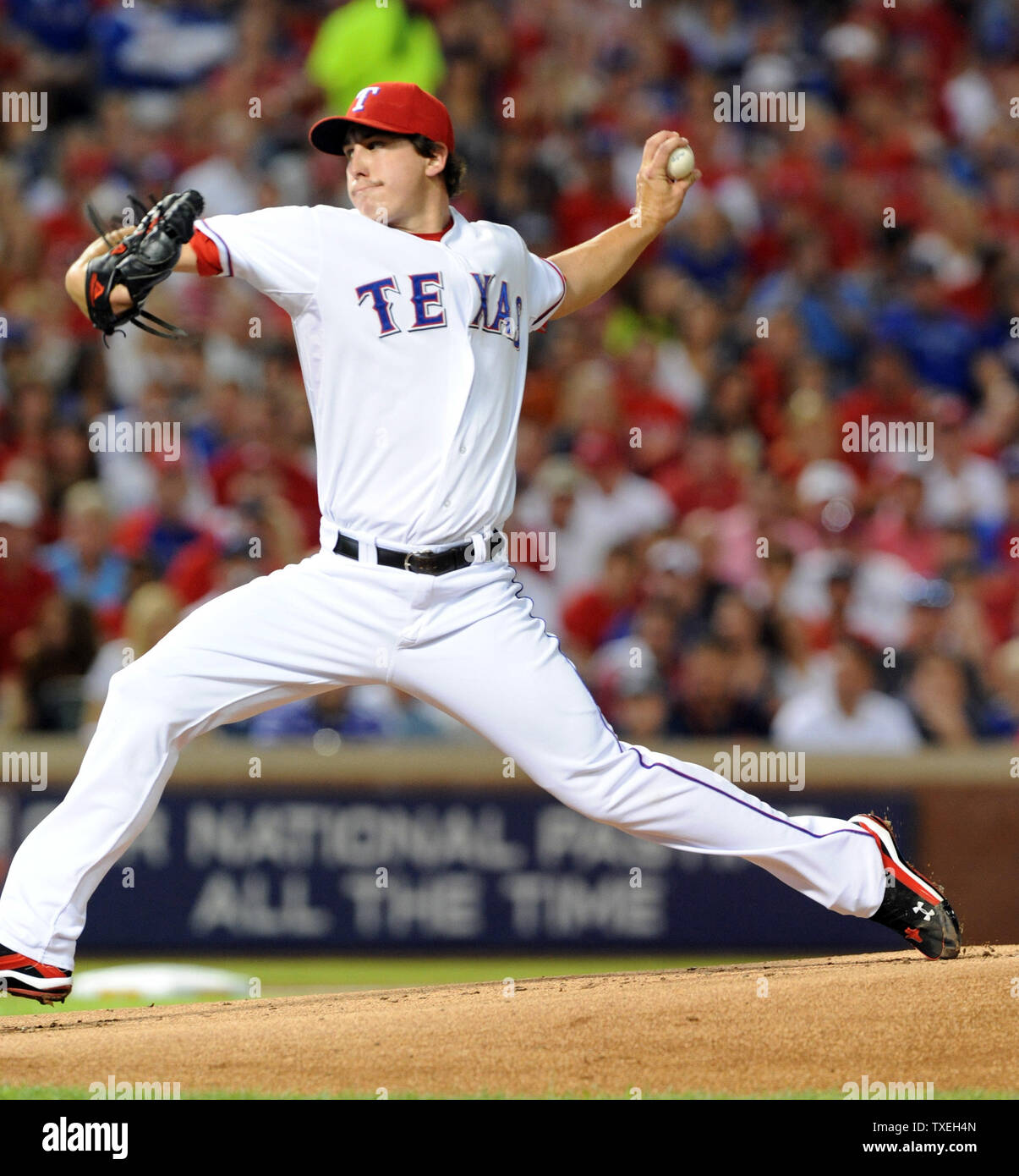 Texas Rangers starting pitcher Derek Holland throws against the Detroit Tigers in game six of the ALCS at Rangers Ballpark in Arlington on October 15, 2011 in Arlington, Texas.   The Rangers lead the best of seven series 3-2.    UPI/Ian Halperin Stock Photo