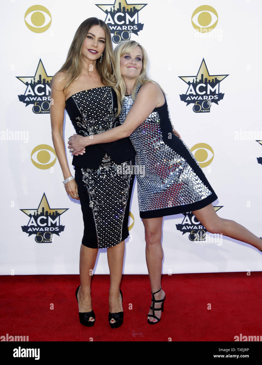 Actresses Sofia Vergara, left, and Reese Witherspoon arrive at the 50th annual Academy of Country Music Awards held at AT&T Stadium in Arlington, Texas on April 19, 2015. Photo by John Angelillo/UPI Stock Photo