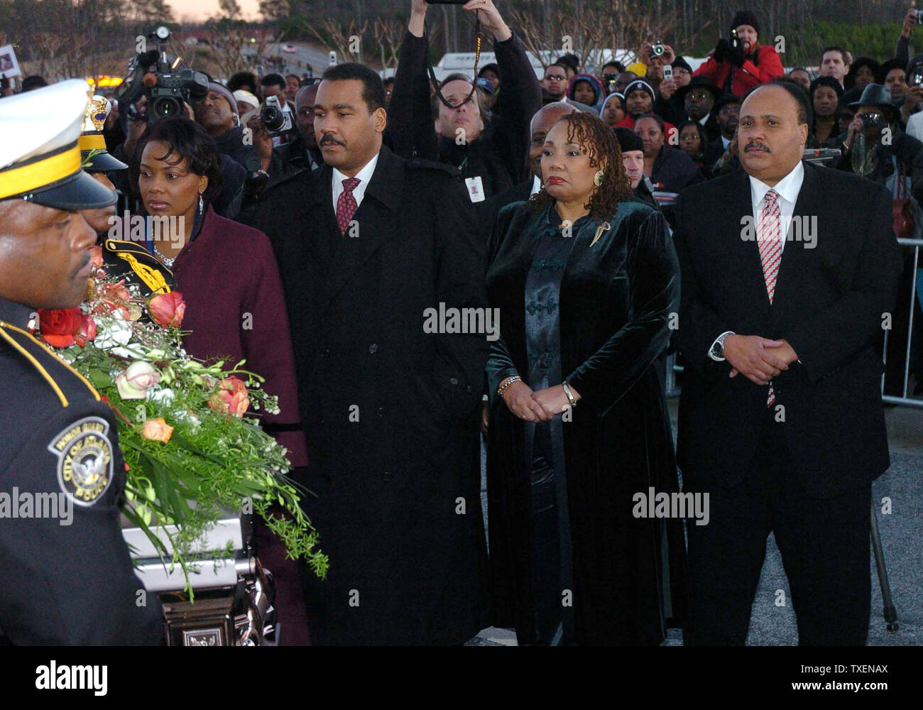 The children of Coretta Scott King, (L-R) Rev. Bernice King, Dexter King, Yolanda King and Martin Luther King III watch as their mother's casket is carried from the New Birth Missionary Baptist Church in Lithonia, Ga., after her funeral service February 7, 2006. Coretta Scott King was the wife of Dr. Martin Luther King Jr.  (UPI Photo/Byron Small) Stock Photo