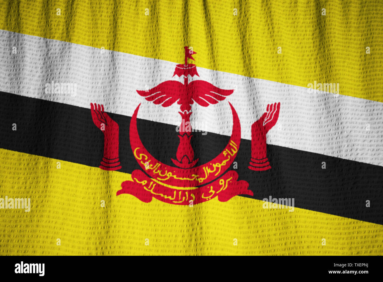 Ruffled Flag of Brunei Blowing in Wind - Stock Image