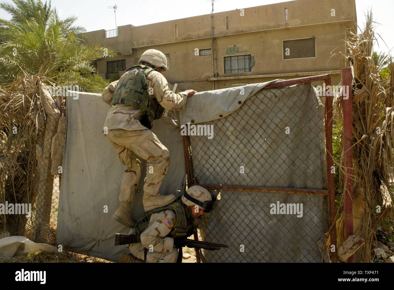 The U.S. Army 1st Cavalry Division search homes of suspected insurgents for weapons and explosives in southwestern Baghdad as part of an operation to help stabilize the country just days before the transfer of sovereignty to Iraq.  (UPI Photo/Mitch Prothero) Stock Photo