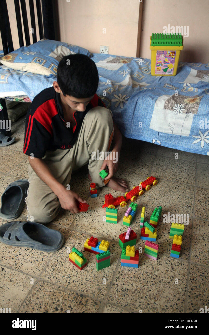 Dirshad Hirmiz plays with toys at the Iraq House, an orphanage