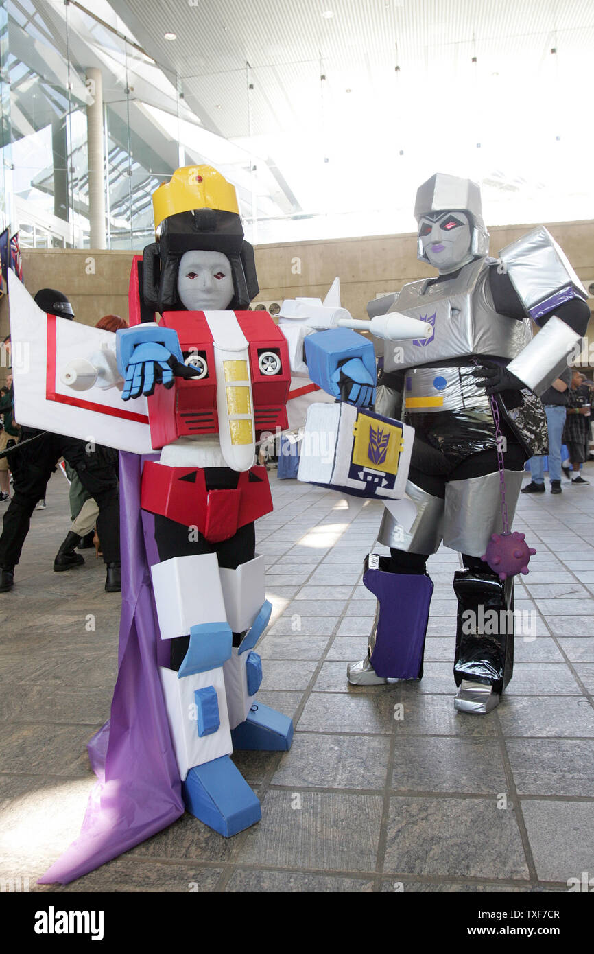 Matthew Howard, 11, of Kingsport, TN is in his costume of Prince Star Scream of the G1 Transformers along with his mother, Amanda as Megara, a female Megatron at the 11th annual Comic Con in Baltimore on August 29, 2010.  UPI/Greg Whitesell - Stock Image