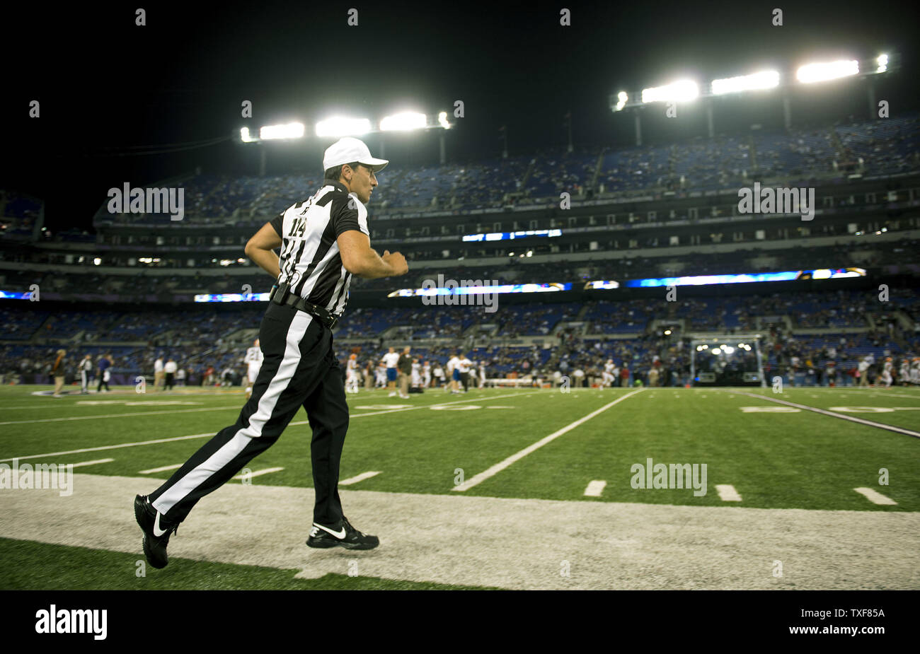 NFL official Gene Steratore takes the field prior to the