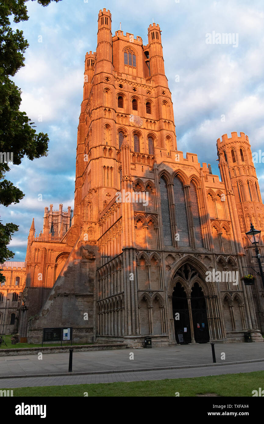 View of Ely Cathedral`s west tower turning a lovely red colour in the setting sun. Stock Photo