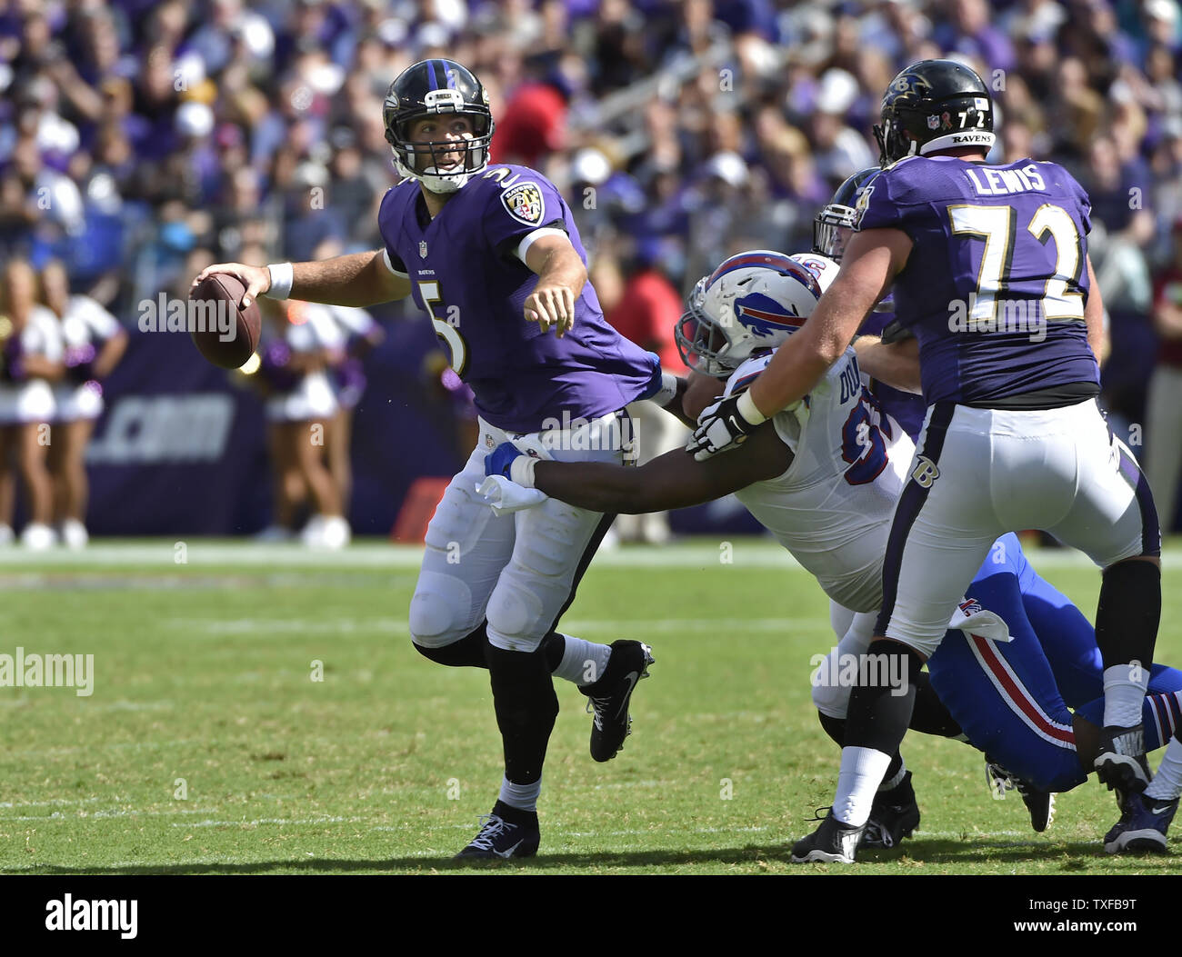 Baltimore Ravens Quarterback Joe Flacco 5 Is Tackled For A Loss By Buffalo Bills Defensive Tackle Leger Douzable 91 During The Second Half Of An Nfl Football Game At M T Bank Stadium