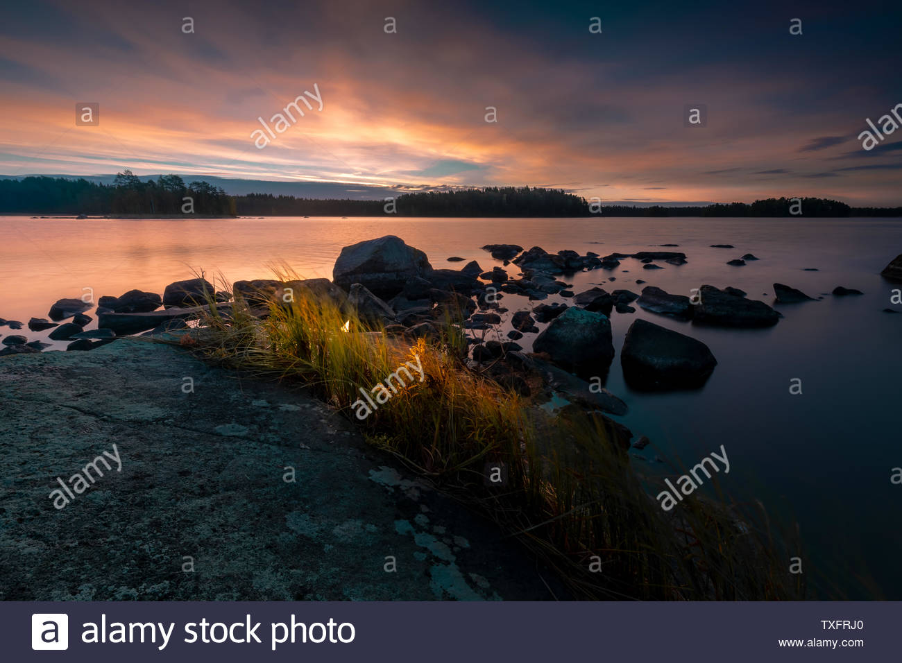 Sunset at the lake in finland - Stock Image