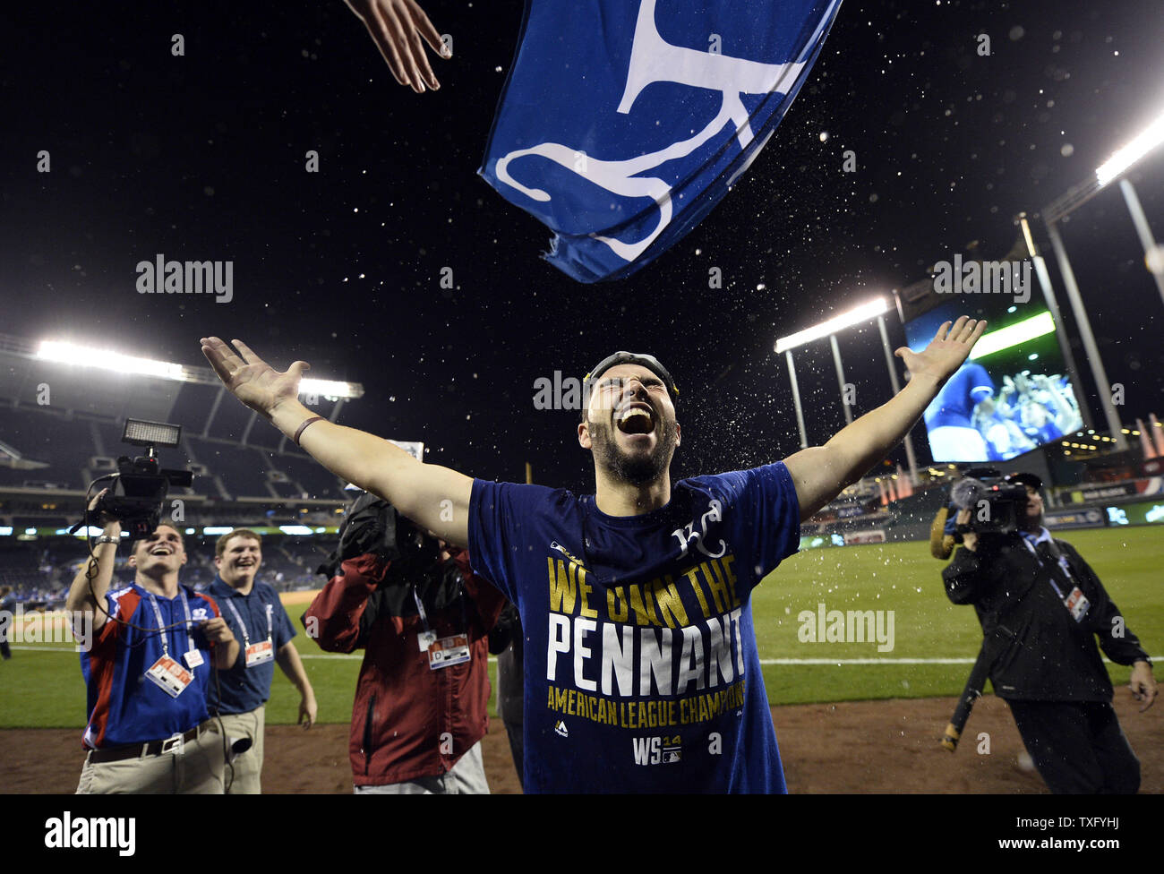 Kansas City Royals' Eric Hosmer is strayed with beer by fans