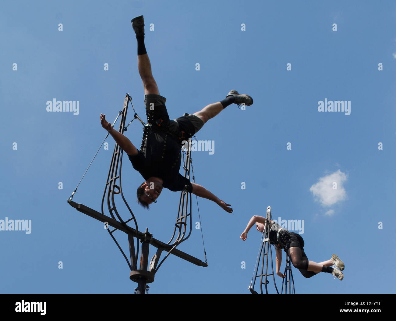 Acrobats perform at the Virgin Mobile Festival at Pimlico Race