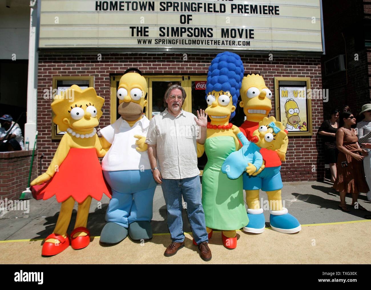 The Simpsons Movie Producer Matt Groening C Waves To The Crowd While Lined Up With The Characters From His Television Show And Movie At The Hometown Premier Of The Simpsons Movie At
