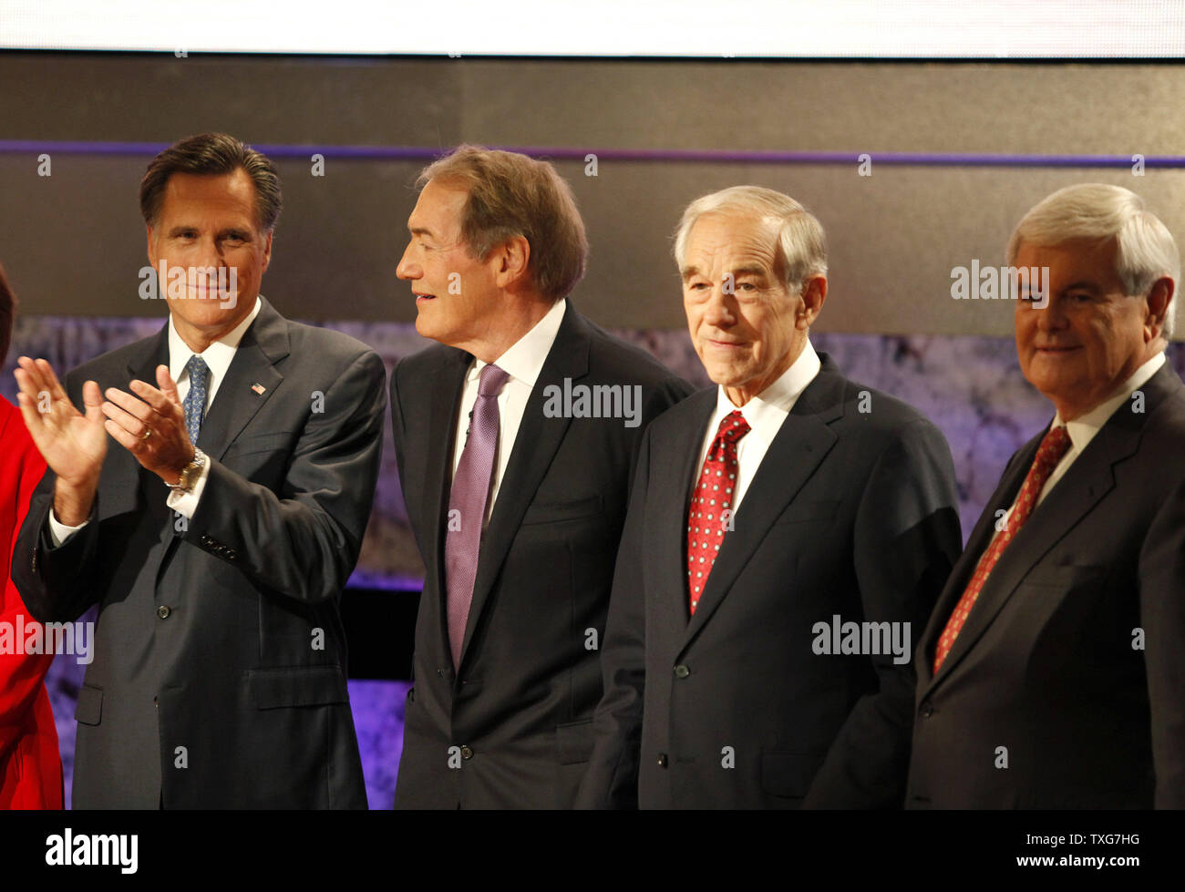 From left, republican candidate for US President and former Massachusetts Governor Mitt Romney, debate moderator Charlie Rose, presidential candidate Texas Representative Ron Paul, and candidate former house speaker Newt Gingrich, line up for a photo-op before the start of the Bloomberg/Washington Post Republican debate inside the Spaulding Auditorium at Dartmouth College in Hanover New Hampshire on October 11, 2011.    UPI/Matthew Healey Stock Photo