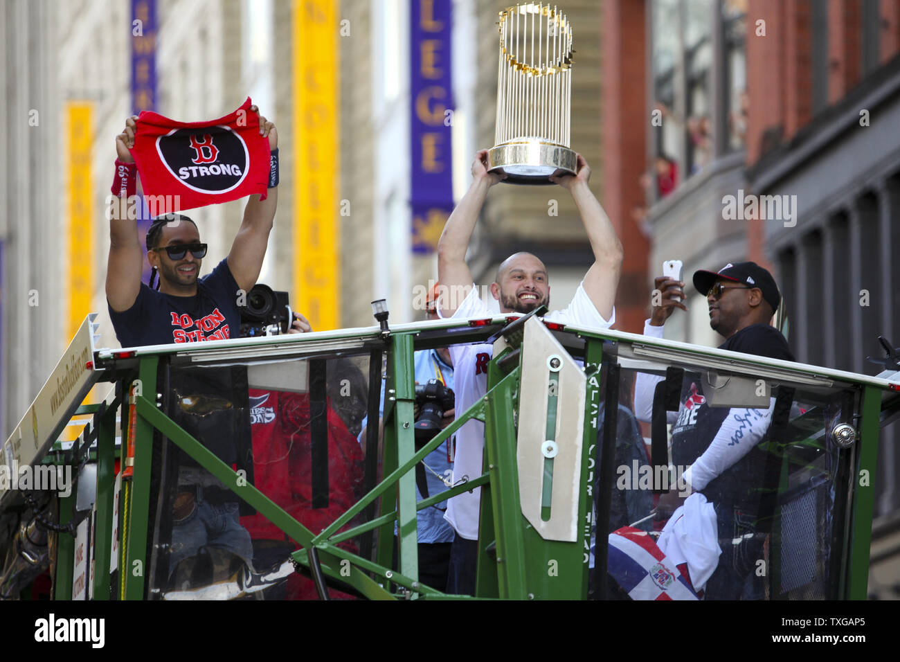 Boston Red Sox right fielder Shane Vicotrino holds up the