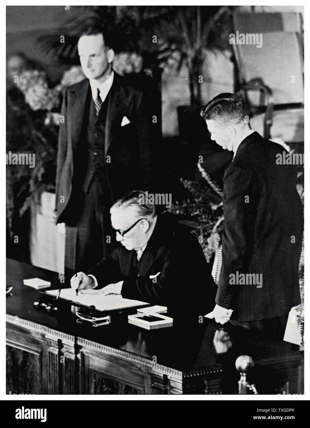 Photograph from the signing of the North Atlantic Treaty. The North Atlantic Treaty, signed in Washington, D.C. on 4 April 1949, is the treaty establishing the North Atlantic Treaty Organization (NATO). Stock Photo