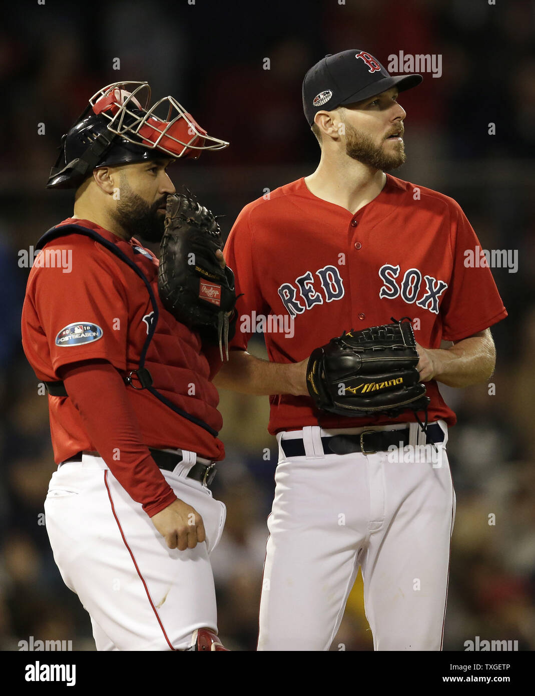 Boston Red Sox pitcher Chris Sale (R) and catcher Sandy Leon