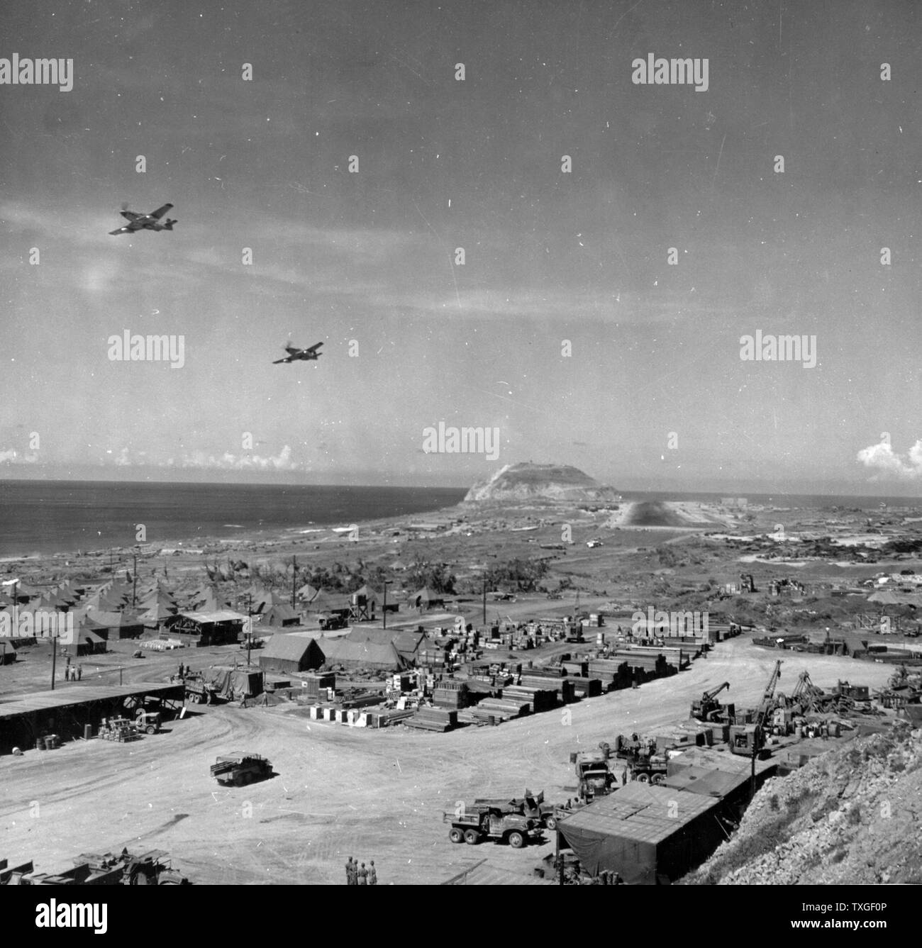 Photograph of the 21st Bomber Command P-51s Flyover in Iwo Jima Bonin Islands, Japan. Dated 1945 - Stock Image