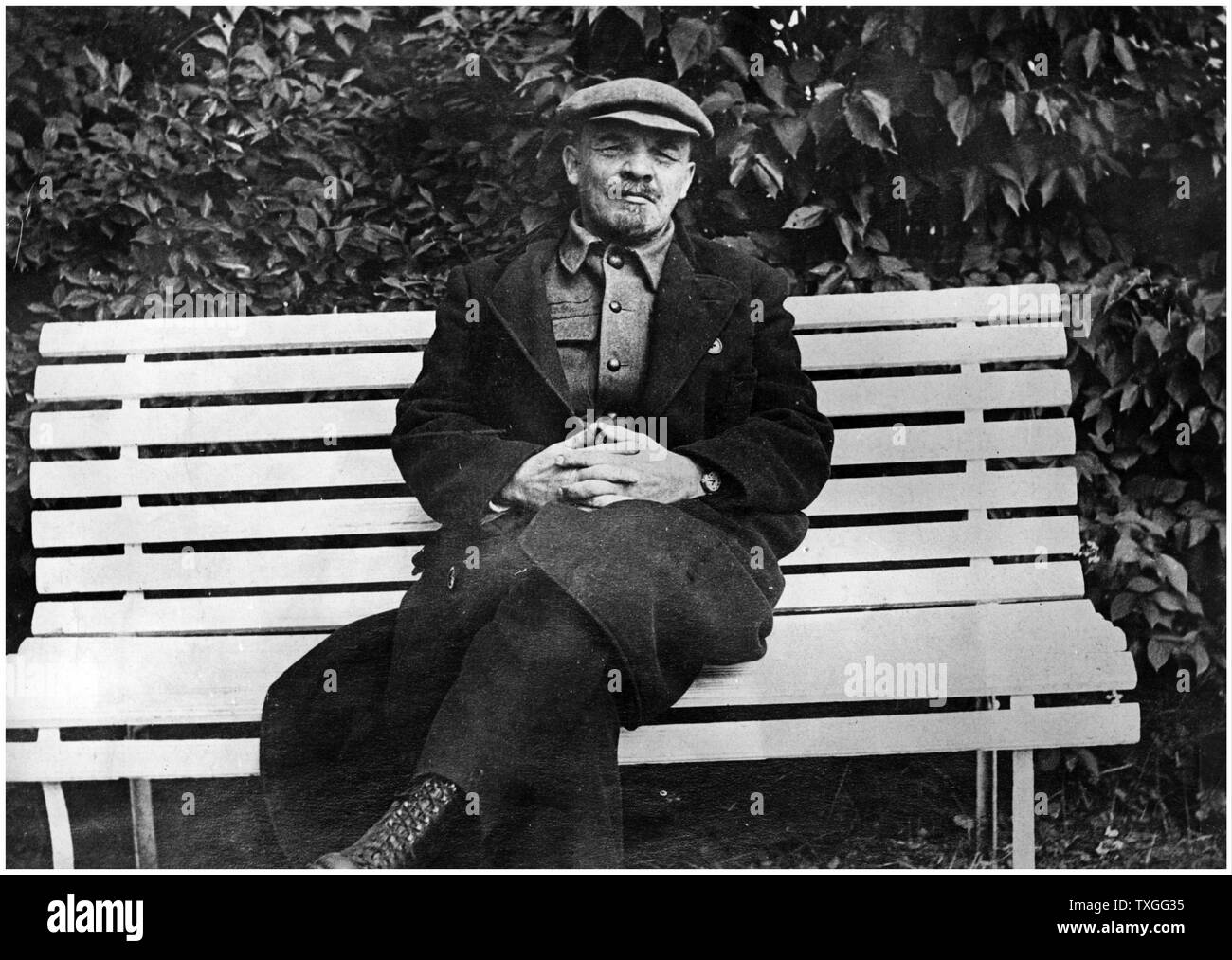 Vladimir Lenin seated on a bench in his garden at his home - Stock Image
