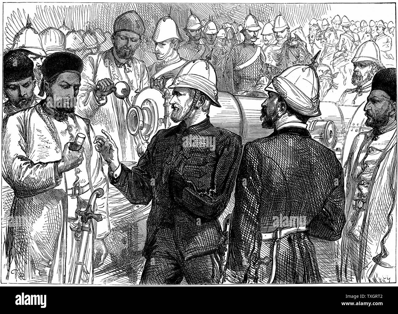 Second Anglo-Afghan War (1878-1880): Yakub (Yakoob) Khan, ruler of Afghanistan, being shown details of British guns during review at Gundamuck shortly after the signing of the Treaty of Gundamuck, 26 May 1879 October 1879   Wood engraving - Stock Image