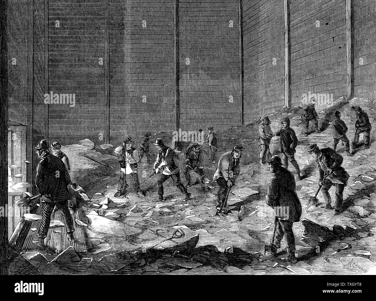 Storing ice in insulated sheds at Charles's Ice Store, Chelsea, London. For use in summer. Wood engraving 1861 - Stock Image